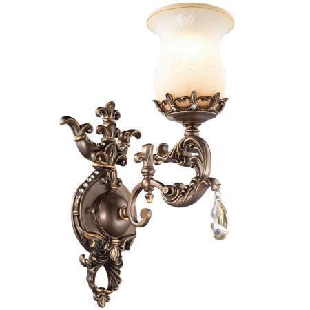 Бра Odeon lightНастенные светильники и бра<br>Тип: бра,<br>Назначение светильника: для гостиной,<br>Стиль светильника: арт деко,<br>Материал светильника: металл, хрусталь,<br>Тип лампы: накаливания,<br>Количество ламп: 1,<br>Мощность: 60,<br>Патрон: Е27,<br>Цвет арматуры: цветной,<br>Ширина: 190,<br>Высота: 450,<br>Коллекция: varza<br>