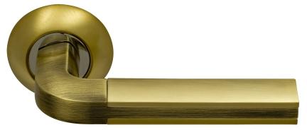 Ручка фалевая ArchieДверная фурнитура<br>Тип дверной фурнитуры: ручка, Материал: ЦАМ, Цвет: золото матовое/античная бронза<br>