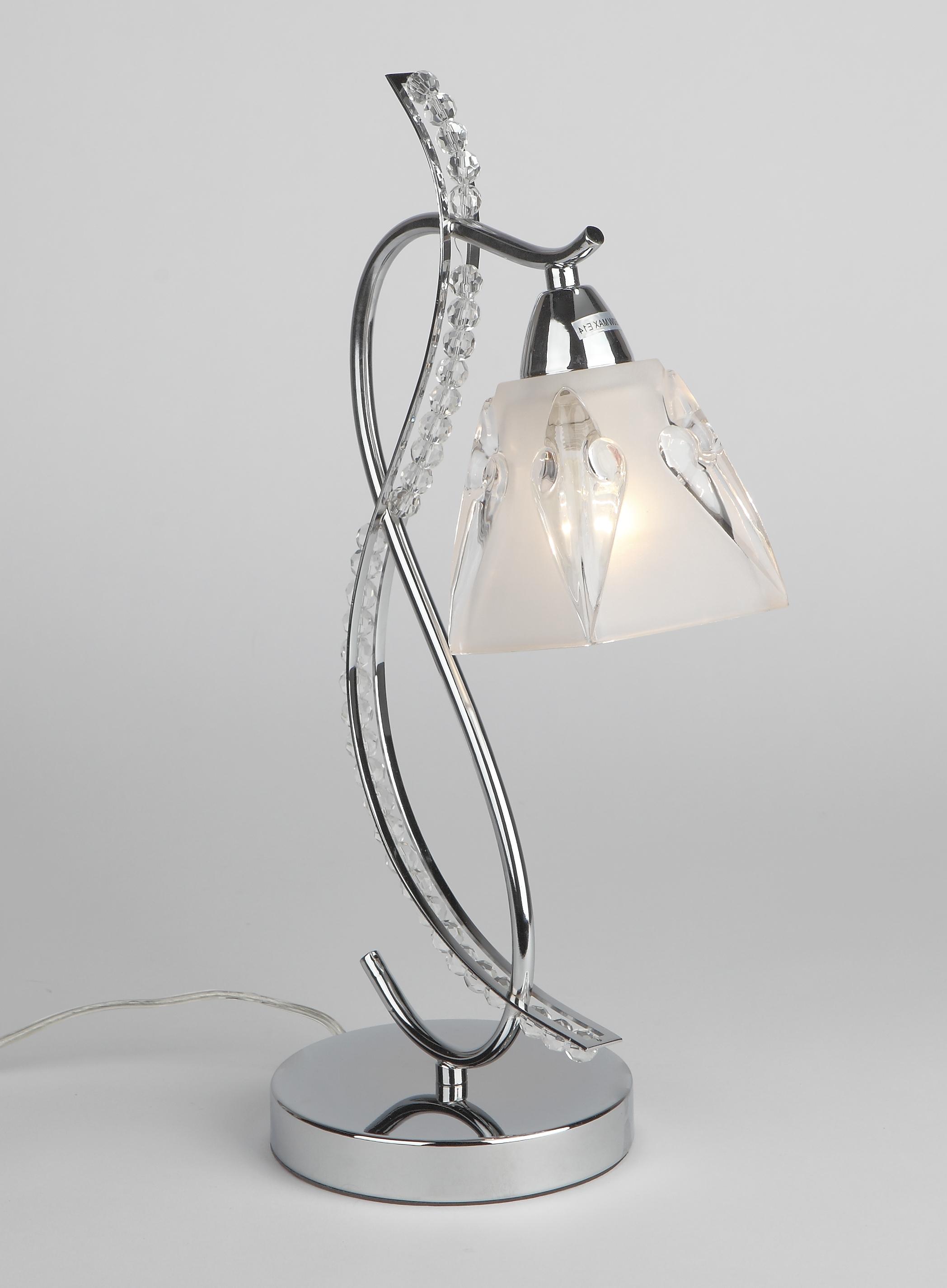 Лампа настольная RivoliЛампы настольные<br>Тип настольной лампы: декоративная,<br>Назначение светильника: для комнаты,<br>Стиль светильника: модерн,<br>Материал светильника: металл, стекло, хрусталь,<br>Длина (мм): 210,<br>Ширина: 150,<br>Высота: 430,<br>Количество ламп: 1,<br>Тип лампы: накаливания,<br>Мощность: 60,<br>Патрон: Е14,<br>Цвет арматуры: белый,<br>Вес нетто: 2.4<br>